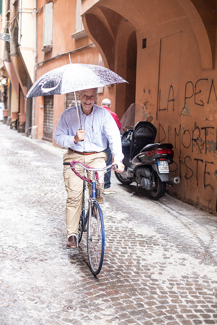 Man cycling with Umbrella
